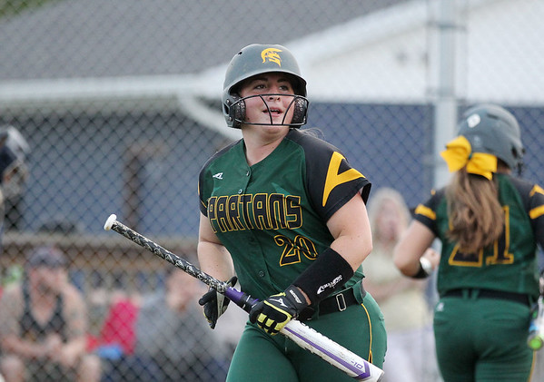 Greenbrier East's (20) smiles after scoring a run during their game against Shady Spring in Shady Spring on Thursday. (Chris Jackson/The Register-Herald)