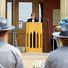 Sharon McGraw, chief magistrate for Fayette County, reads off the names of law enforcement officer that have been killed in the line of duty in West Virginia's history during the annual police memorial at the Fayette County Courthouse in Fayetteville on Monday. (Chris Jackson/The Register-Herald)