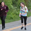 (Brad Davis/The Register-Herald) Caitlyn Daniels (left), 15, participates in a 5K Glow Walk/Run she and her friend Maggie Little, 16, organized together to raise awareness for juvenile diabetes Friday night at the YMCA Paul Cline Memorial Sports Complex. The Woodrow Wilson sophomores both have type 1 diabetes and organized the event to both shed light on the issue and to raise money for the Juvenile Diabetes Research Foundation.