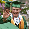 (Brad Davis/The Register-Herald) Graduatiing Greenbrier East senior Colby Johnson reaches for a high five from a fellow senior during the school's 48th annual commencement ceremony Saturday night at the State Fairgrounds in Fairlea.