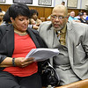 (Brad Davis/The Register-Herald) Mayoral candidate Cedric Roberston and his wife Drema monitor election results as they come at the Raleigh County courthouse Tuesday night.