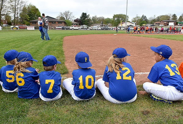 (Brad Davis/The Register-Herald) Young teeball players, coaches and families line up on the Beckley Little League field during an opening day ceremony for the teeball league Saturday afternoon.