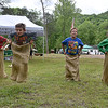 (Brad Davis/The Register-Herald) Youngsters (from left) Dannie Mann, 11, Miguel Rossi-Averill, 8, David Mann, 9, and Sage Storm, 9, hustle along during a sack race at Camp Brookside May 21.