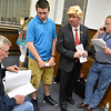 (Brad Davis/The Register-Herald) West Virginia Miners owner Doug Epling, left, reads off results as Reedy Construction owner Kevin Reedy (2nd from right), dressed up like Donald Trump for the occasion, and his son Cody (2nd from left) listen in while Magistrate Steve Massie, right, checks results by phone at the Raleigh County courthouse Tuesday night.