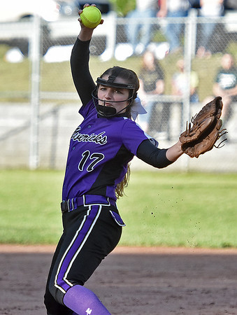 (Brad Davis/The Register-Herald) James Monroe starting pitcher Alexis Carter delivers during the Mavericks' regional championship win over Wyoming East Thursday evening in New Richmond.