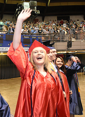 Samitha Webb, waves to her parents during Independence High School graduation held at the Beckley-Raleigh County Convention Center Saturday morning.