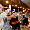 (Brad Davis/The Register-Herald) Raleigh County Circuit Judge Robert Burnside, left, raises his glass of champaign in thanks as he addresses family and supporters following his re-election Tuesday night at the old McBee's location.