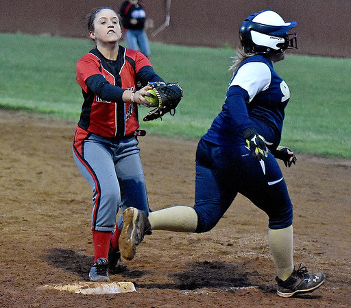 (Brad Davis/The Register-Herald) Shady Spring's Jesslyn Hughes just barely beats Oak Hill first baseman Kayla Anderson to the bag during the 5th inning of the Tigers' win over the Lady Red Devils Wednesday night at Woodrow Wilson High School.