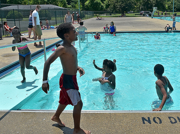 (Brad Davis/The Register-Herald) Several area residents flocked to the New River Park pool on its opening day to beat the heat Saturday afternoon.