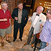 (Brad Davis/The Register-Herald) Raleigh County Circuit Judge Robert Burnside, 2nd from right, has a glass champaign and a few laughs with friends (from left) John Rist, Kyle Lusk and Victor Flanagan following his re-election Tuesday night at the old McBee's location.