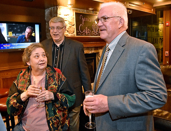 (Brad Davis/The Register-Herald) Beckley Mayor-elect Rob Rappold, right, chats with outgoing mayor Bill O'Brien and his wife Lynn shortly before being declared the winner at his election headquarters in the old McBee's location Tuesday in Beckley