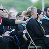 Greenbrier West School Counselor Mellissa Krystynak, right, is consoled by Antonio Junaeda, Spanish teacher, left, during Christopher Flanagan's speech during their  Class of 2016 graduation Friday at the State Fairgrounds in Fairlea. (Flanagan, who graduated his class with highest honors, thanked the counselor for her help to him and the rest of the class. (Chris Jackson/The Register-Herald)