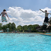 (Brad Davis/The Register-Herald) Young swimmers leap from the diving boards during opening day at the New River Park pool Saturday afternoon.