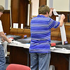 (Brad Davis/The Register-Herald) Election officials tabulate votes from incoming precincts Tuesday night at the Raleigh County courthouse.
