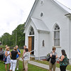 (Brad Davis/The Register-Herald) Area residents mingle outside the Sacred Heart Catholic Church in Meadow Bridge following mass Sunday afternoon. The church itself has been in service for 140 years and the annual picnic has been going on every year for almost as long.
