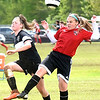 Hannah Johnson, of Fury Crush U12, right, heads the ball away from Bailey Fisher, of WVFC 2003, during the WVSA State Cup held at the YMCA Paul Cline Memorial Youth Sports Complex in Beckley.<br /> (Rick Barbero/The Register-Herald)