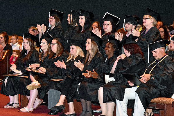 (Brad Davis/The Register-Herald) Valley College graduates applaud their classmates as they're called one by one to the stage during the school's Spring Commencement Ceremony Friday evening at Church of God Family Worship Center.