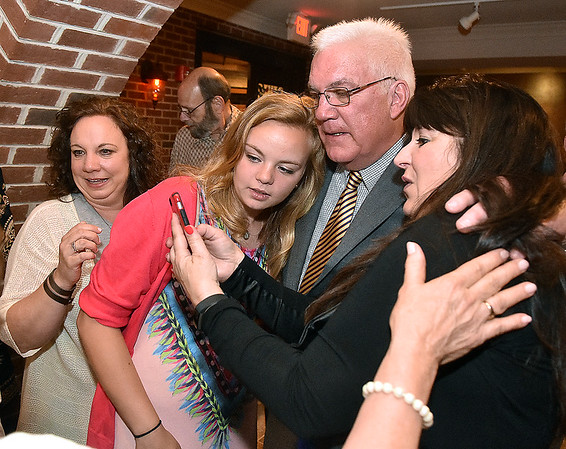 (Brad Davis/The Register-Herald) Beckley Mayor-elect Rob Rappold, second from right, check incoming results with his granddaughter Sarah White, left of Rappold, and Tammy Hancock, right, at his election headquarters in the old McBee's location Tuesday night in Beckley.
