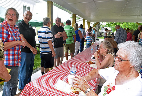 (Brad Davis/The Register-Herald) Area residents already eating share some laughs and good times with those waiting in line still as they enjoy an annual Memorial Day picnic Sunday afternoon at the Sacred Heart Catholic Church in Meadow Bridge following mass. The church itself has been in service for 140 years and the annual picnic has been going on every year for almost as long. The event usually draws between 100 and 250 people, with this year's turnout at around 120.