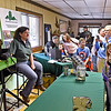 (Brad Davis/The Register-Herald) Three Rivers Avian Center executive director Wendy Perrone, left, stands by to answer any questions passing visitors might have about Regis the bald eagle, who sits next to her during a Spring Migration Celebration Saturday morning at Little Beaver State Park. TRAC brought the veteran traveler Regis and a few other raptors along to the annual event, which also featured educational games and activities designed to teach kids the importance of all of nature's creatures.