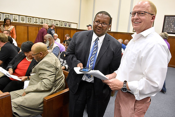 (Brad Davis/The Register-Herald) City Council candidates Ron Booker, left, and Jeff Shumate monitor incoming election results as mayoral candidate Cedric Robertson (background left) and his wife Drema do the same Tuesday night at the Raleigh County courthouse.