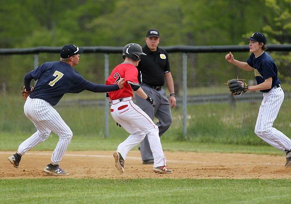 Shady Spring's Keith Sexton tags out Oak Hill's (2) <br /> during their Class AAARegion 3, Section 1 tournament game Monday in Oak Hill. Oak Hill won 9-3. (Chris Jackson/The Register-Herald)
