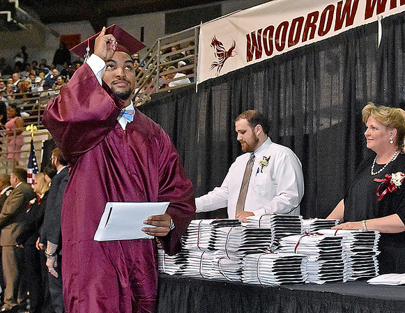 (Brad Davis/The Register-Herald) Woodrow Wilson graduate Sidney Burgess points to the sky after receiving his degree during the school's 90th Commencement Ceremony Saturday evening at the Beckley-Raleigh County Convention Center.