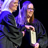 (Brad Davis/The Register-Herald) Valley College graduate Emily Grove receives her Medical Clinical Assistant diploma from Vice President Beth Gardner during the school's Spring Commencement Ceremony Friday evening at Church of God Family Worship Center.