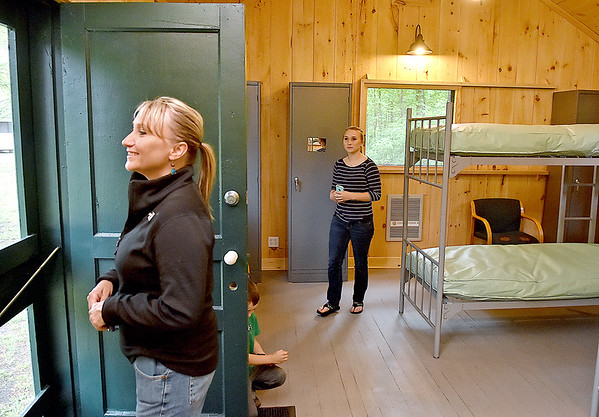 (Brad Davis/The Register-Herald) Beth Fish, left, and her daughter Shelby Jarvis look over the camp from inside one of the renovated cabins at the historic and newly revitalized Camp Brookside Saturday afternoon in Brooks near Hinton. Fish was married at the camp in 1990, and the door inside this cabin still has her name on it.