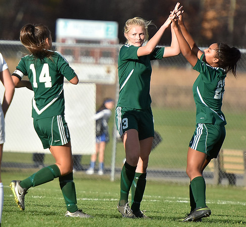 (Brad Davis/The Register-Herald) Winfield goal scorer Mary Lawman celebrates with teammates after putting one in the net against Fairmont Senior Friday evening at the YMCA Paul Cline Memorial Soccer Complex.