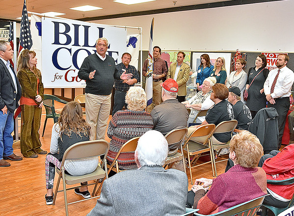 (Brad Davis/The Register-Herald) Flanked on both sides by fellow republican politicians, state gubernatorial candidate Bill Cole speaks to supporters during a rally at his election headquarters at the Cranberry Shopping Center Sunday night.