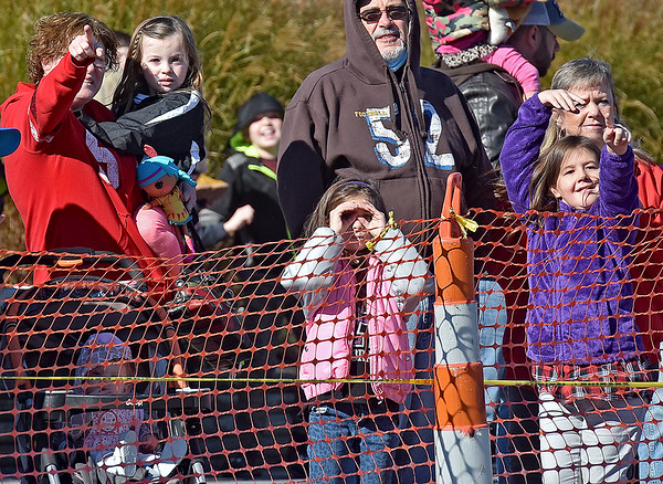 (Brad Davis/The Register-Herald) Eager youngsters spot and point out the approaching helicopter in the sky carrying Santa Claus to his opening day appearance at the Crossroads Mall Saturday afternoon.