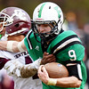 Fayetteville's Jordan Dempsey (9) blocks a defender in route for a rushing touchdown during their Class A quarterfinal football game against Wheeling Central Saturday in Fayetteville. (Chris Jackson/The Register-Herald)