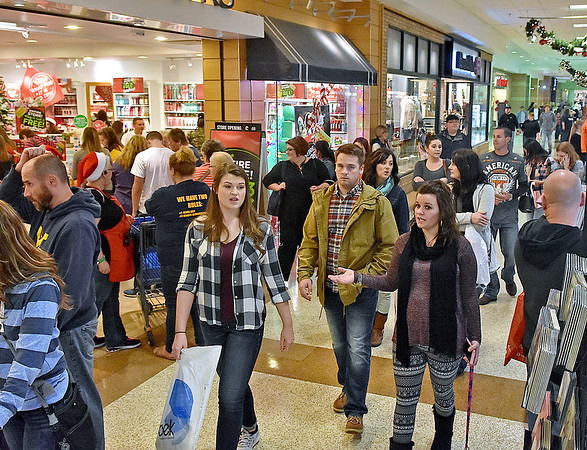 (Brad Davis/The Register-Herald) Black Friday shopping crowds filled the Crossroads Mall into the evening hours yesterday.