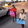 "(Brad Davis/The Register-Herald) Church members Cathy Abernathy, middle, April Puzzuoli, lower right, and a handful of other demonstrators wave at passing motorists as they ""Stand on the Side of Love"" along Neville Street in front of Jim Word Memorial Park Thursday night. Stressing that it was not a protest, members of Beckley's New River Unitarian Universalist Fellowship, located at 911 South Kanawha Street, got out to encourage people to relax and have a little love for another following an intense election season."