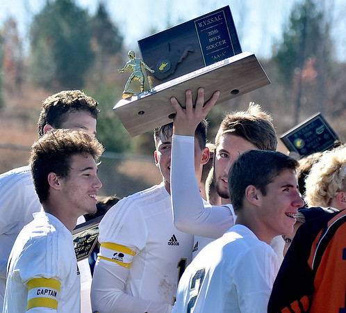 (Brad Davis/The Register-Herald) East Fairmont players clebrate with the trophy after claiming the Class A/AA Boys State Championship Saturday morning at the YMCA Paul Cline Memorial Sports Complex.