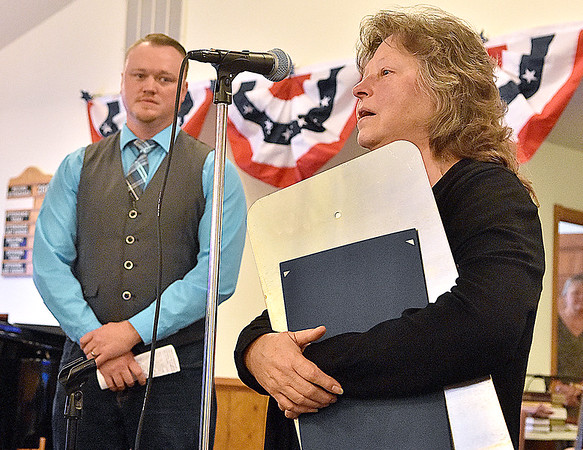 (Brad Davis/The Register-Herald) From left, Shirley Stover-Estep, twin sister of the late Shelby Dean Stover, talk about her brother and shares a few words of thanks during special Veteran's Service at Ewing Creek Church Sunday afternoon in Clear Creek. Church member Kent Taylor looks on at left.