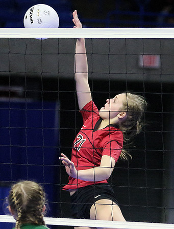 (Brad Davis/The Register-Herald) PikeView's Brooklyn Cook sends the ball over during the Panthers' opening round win in the class AA State Volleyball Tournament Friday morning at the Charleston Civic Center.