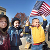 Andrew Clark, 3, from left, Anthony Clark, 4, and Aiden Clark, 5, children of John and Christy Clark, of Beckley, watching the Beckley Veterans Day Parade from Heber Street.<br /> (Rick Barbero/The Register-Herald)