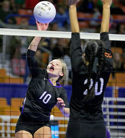 (Brad Davis/The Register-Herald) James Monroe's Gracie Mann hits the ball as Chapmanville's Abigail Marcum defends during the Mavericks' opening round win in the class AA State Volleyball Tournament Friday morning at the Charleston Civic Center.