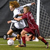 (Brad Davis/The Register-Herald) George Washington's Noah Shaak battles for possession with Jefferson's Robert Gianniny Friday night at the YMCA Paul Cline Memorial Soccer Complex.