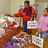 (Brad Davis/The Register-Herald) Beckley resident Carla Davis looks over items at the Dragon Fly Quilts booth as 10-year-old Aniylah Pullen looks on inside the Grant building during the first ever Small Business Saturday shopping event yesterday in Uptown Beckley.