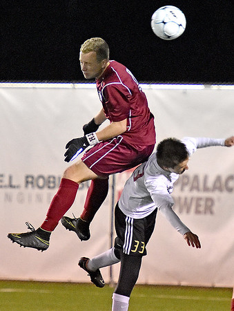 (Brad Davis/The Register-Herald) George Washington's Dylan Brack leaps for a header with Jefferson's Trevor Stuart Friday night at the YMCA Paul Cline Memorial Soccer Complex.