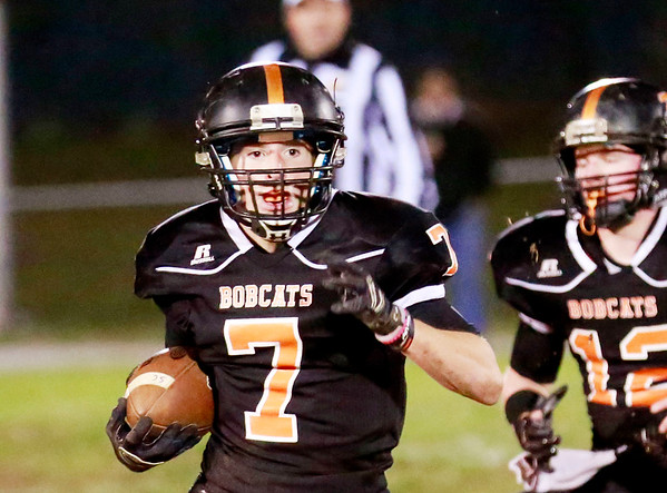 Summers County's Tucker Lilly (7) looks to run against Mount View Friday in Hinton. (Chris Jackson/The Register-Herald)