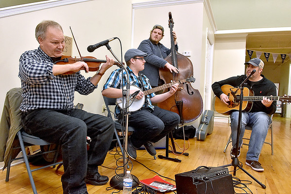 (Brad Davis/The Register-Herald) The Long Point String Band performs inside the Grant building during the first ever Small Business Saturday shopping event yesterday in Uptown Beckley.