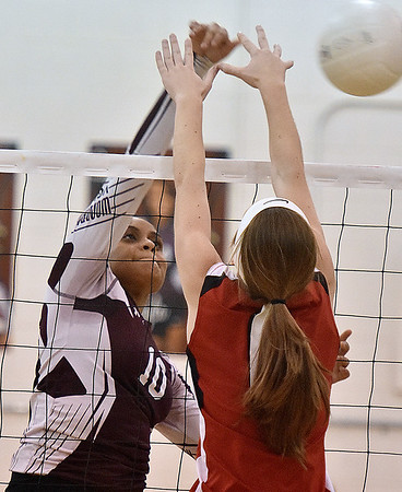 (Brad Davis/The Register-Herald) Woodrow Wilson's Dejaha Morris hits the ball during the Flying Eagles' win over the Red Dragons Saturday night in Beckley.