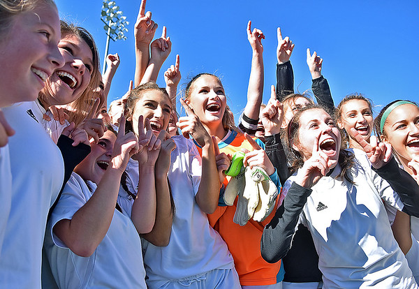 (Brad Davis/The Register-Herald) The Winfield Generals celebrate after claiming the Class AA/A girls State Championship Saturday at the YMCA Paul Cline Memorial Sports Complex.