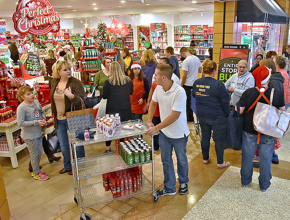 (Brad Davis/The Register-Herald) Activity buzzes outside of Bath & Body Works during a busy Black Friday at the Crossroads Mall yesterday evening.