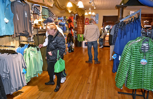 (Brad Davis/The Register-Herald) Customers browse inside Otter & Oak Outfitters in Hinton Friday afternoon. While the major retailers were having sales on Black Friday, other local businesses like Otter & Oak are having their sales on Small Business Saturday.