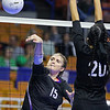 (Brad Davis/The Register-Herald) James Monroe's Whitney Hunt hits the ball as Chapmanville's Abigail Marcum defends during the Mavericks' opening round win in the class AA State Volleyball Tournament Friday morning at the Charleston Civic Center.
